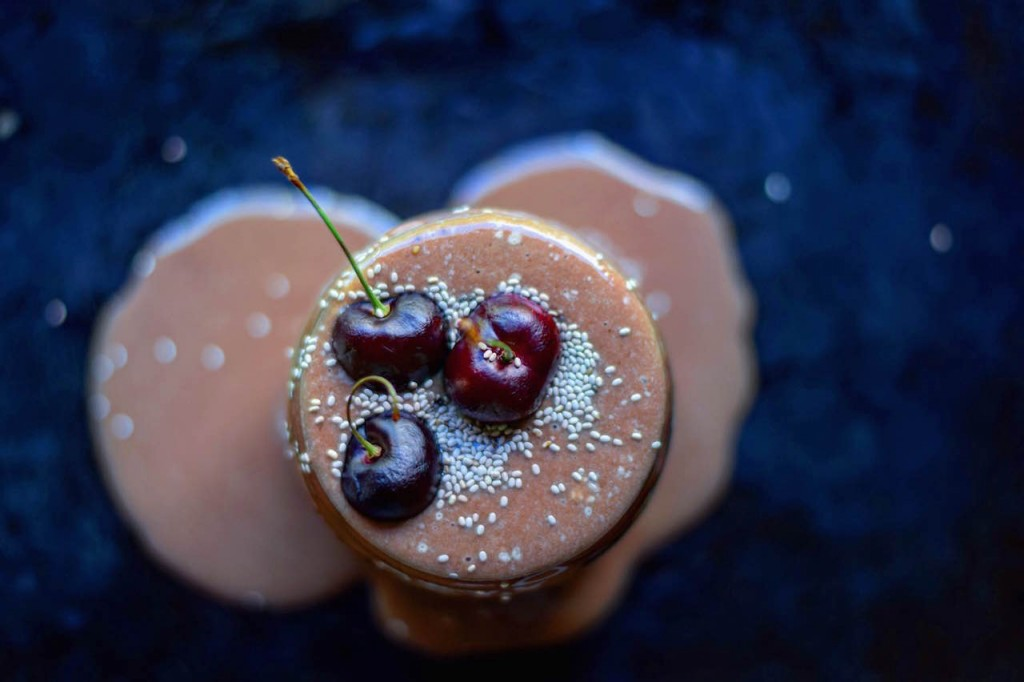 Overhead shot of one of my fav Arbonne Shake Recipes with cherries on top.