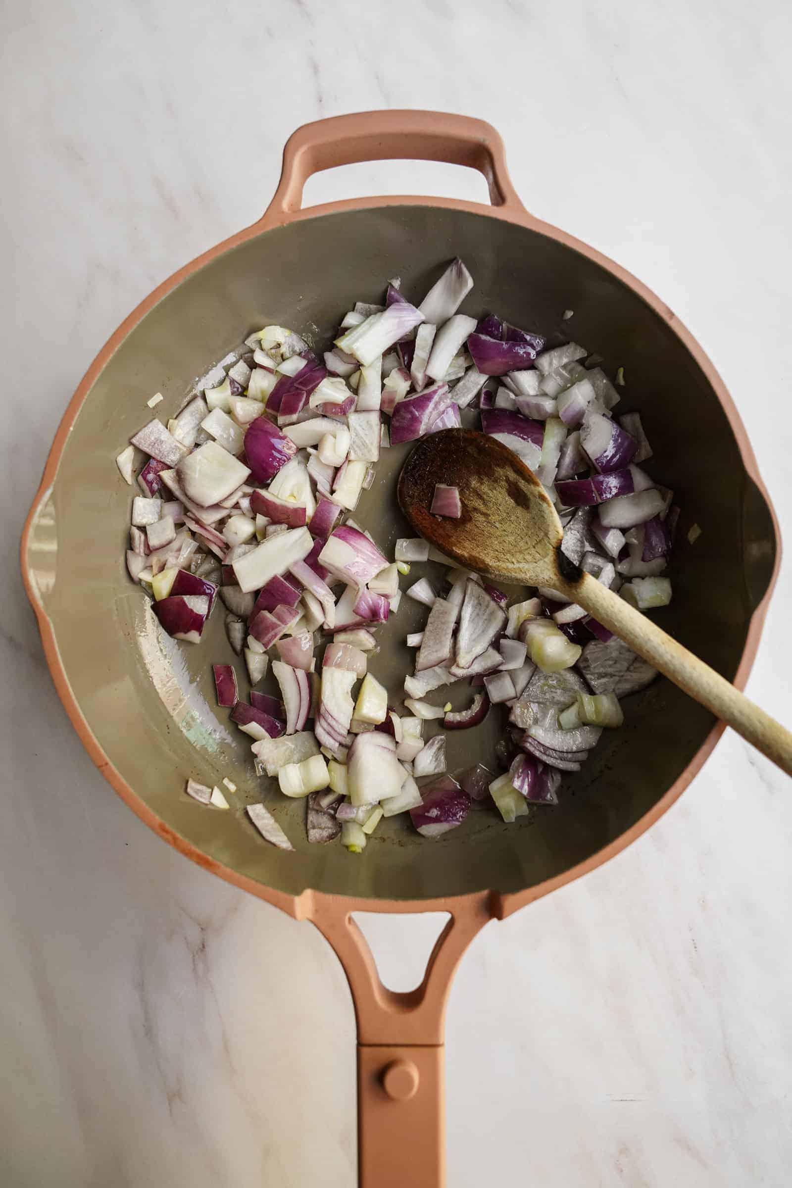 Onions in pan for vegan pasta sauce