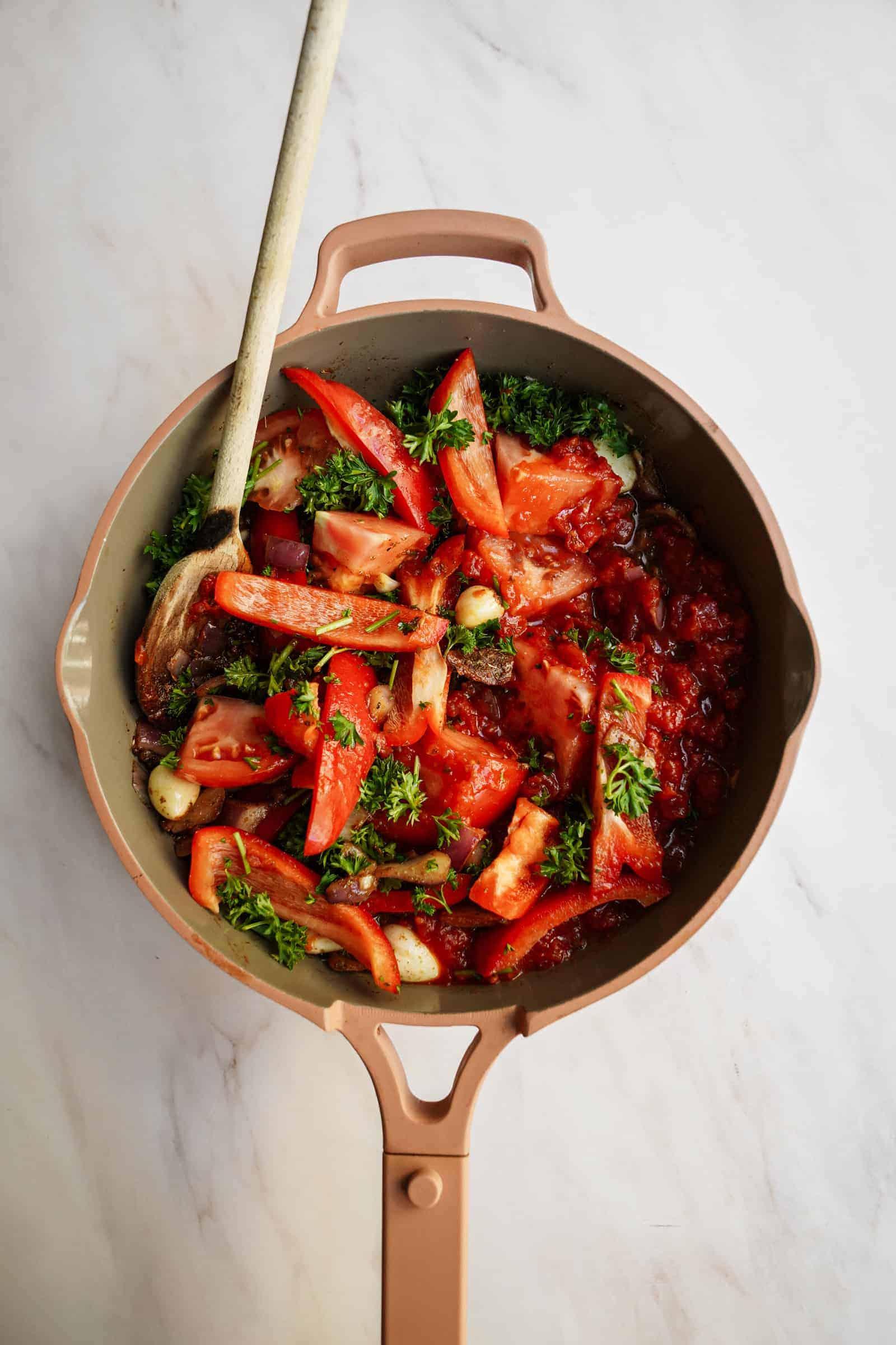 Tomatoes in pot for vegan pasta recipes
