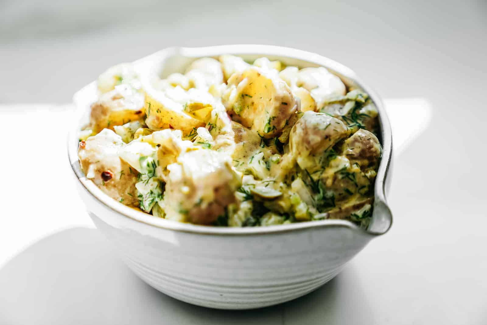 Big bowl of vegan potato salad. Creamy & ready to eat.