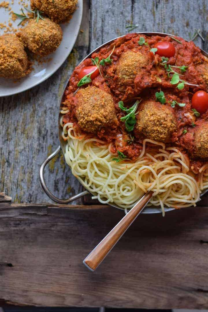 Vegan Pasta Recipe with meatless meatballs on counter ready to be served.