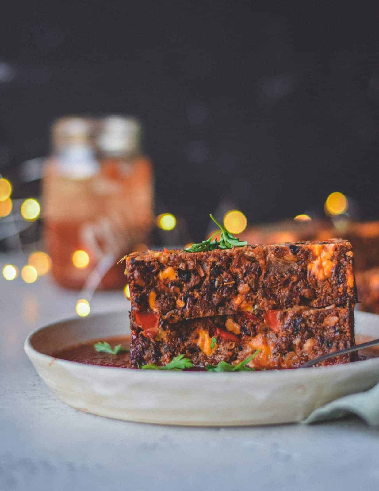 Holiday Nut Roast Recipe stacked on top of serving dish.