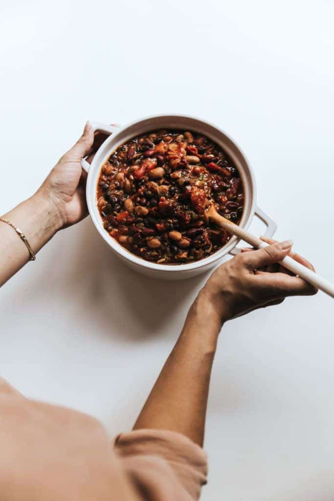 This super simple and extremely versatile vegan chilli is loaded with beans and lentils that'll warm your insides this winter.