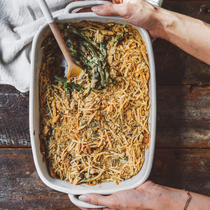 Take your holiday side dish to the next level with this vegan green bean casserole finished with a crunchy Triscuit cracker topping.