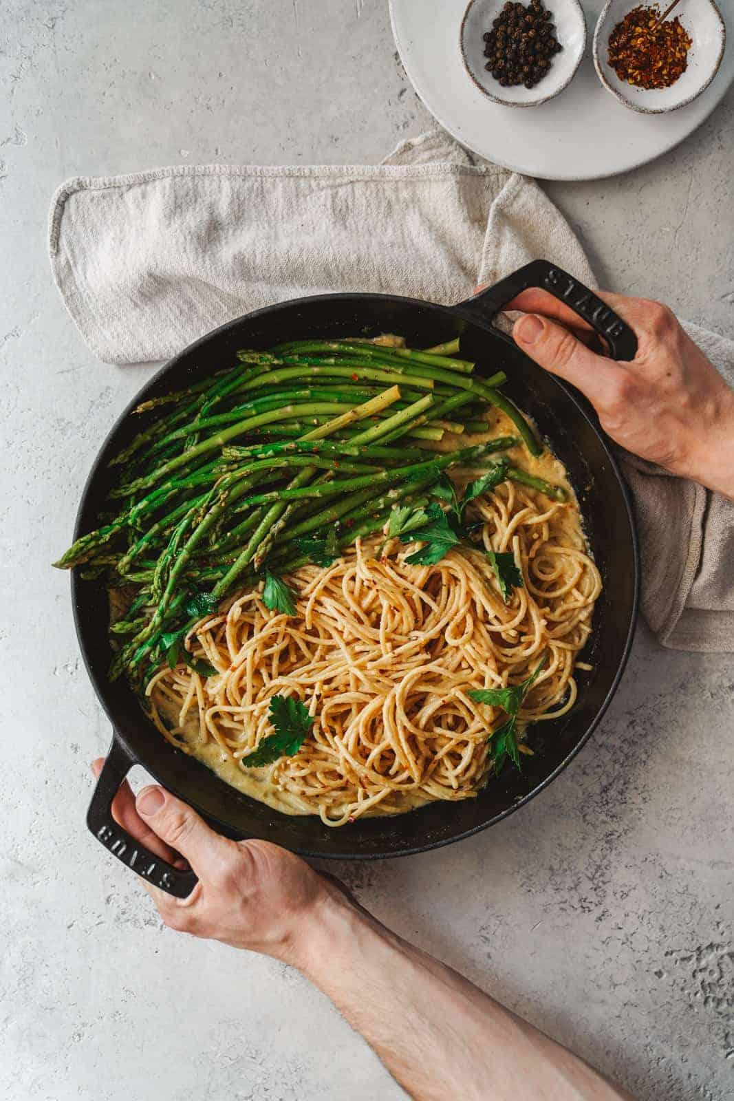 Big pan of spaghetti with asparagus and white wine spaghetti sauce.