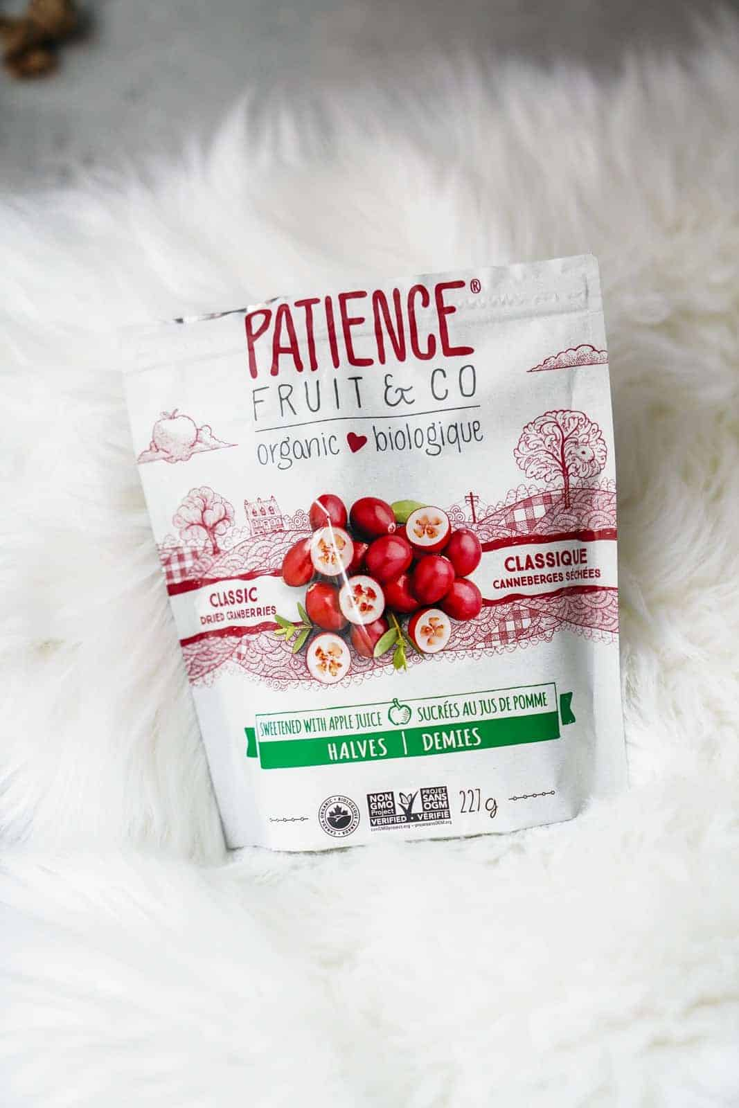 Patience Fruit & Co. Organic Vegan Cranberries laying on fluffy rug.