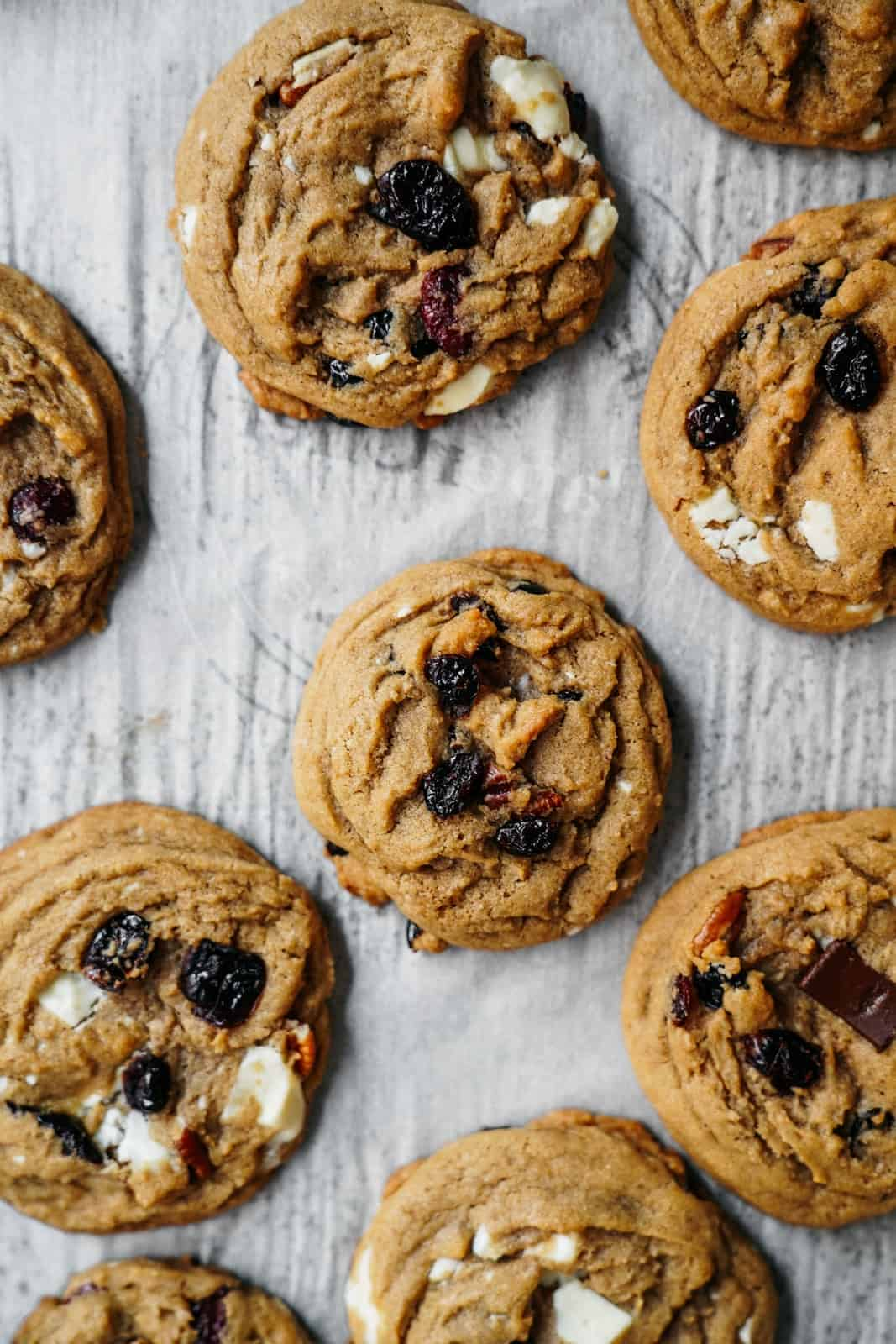 These plant-based, one bowl, vegan christmas cookies with white and dark chocolate chip cranberry cookies are super easy to make and are perfectly chewy and delicious!