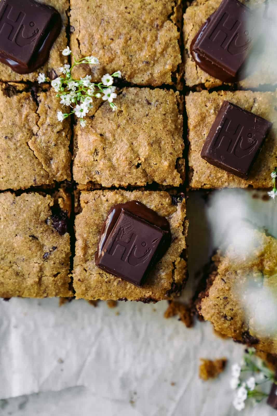 Overhead shot of vegan blondies with chocolate chunks.