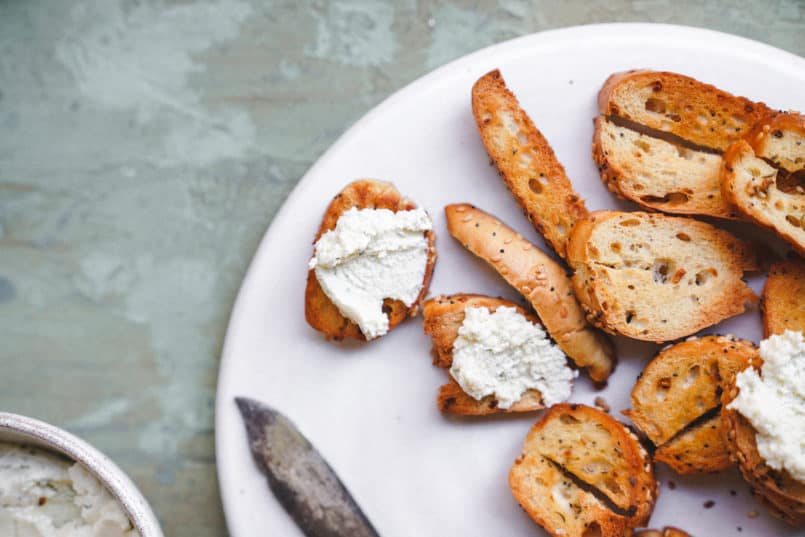 This vegan garlic herb cream cheese is so smooth and rich, it is perfect for spreading over the Silver Hills Organic Everything Bagels.
