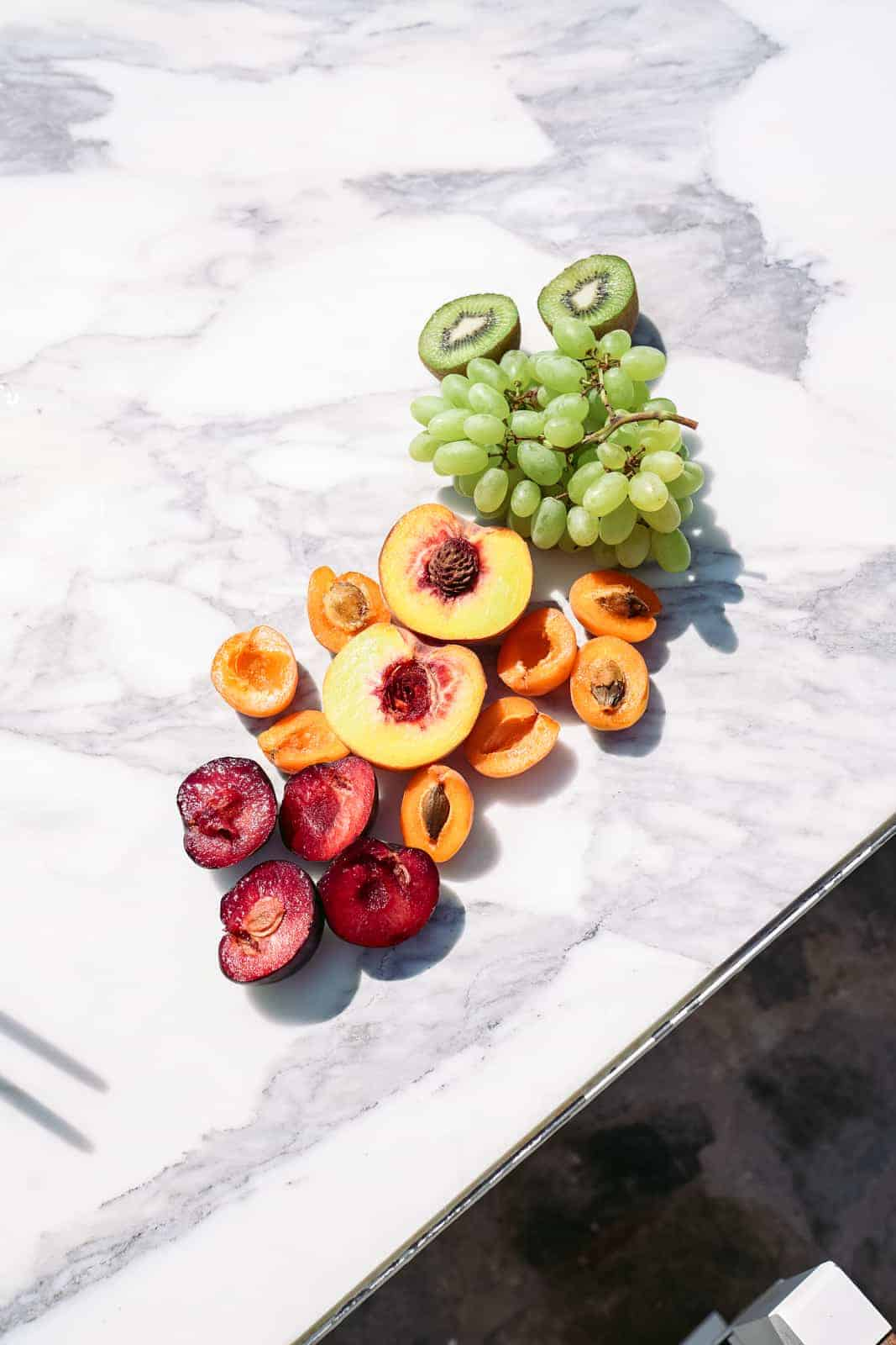 Healthy fruit on a white marble table.