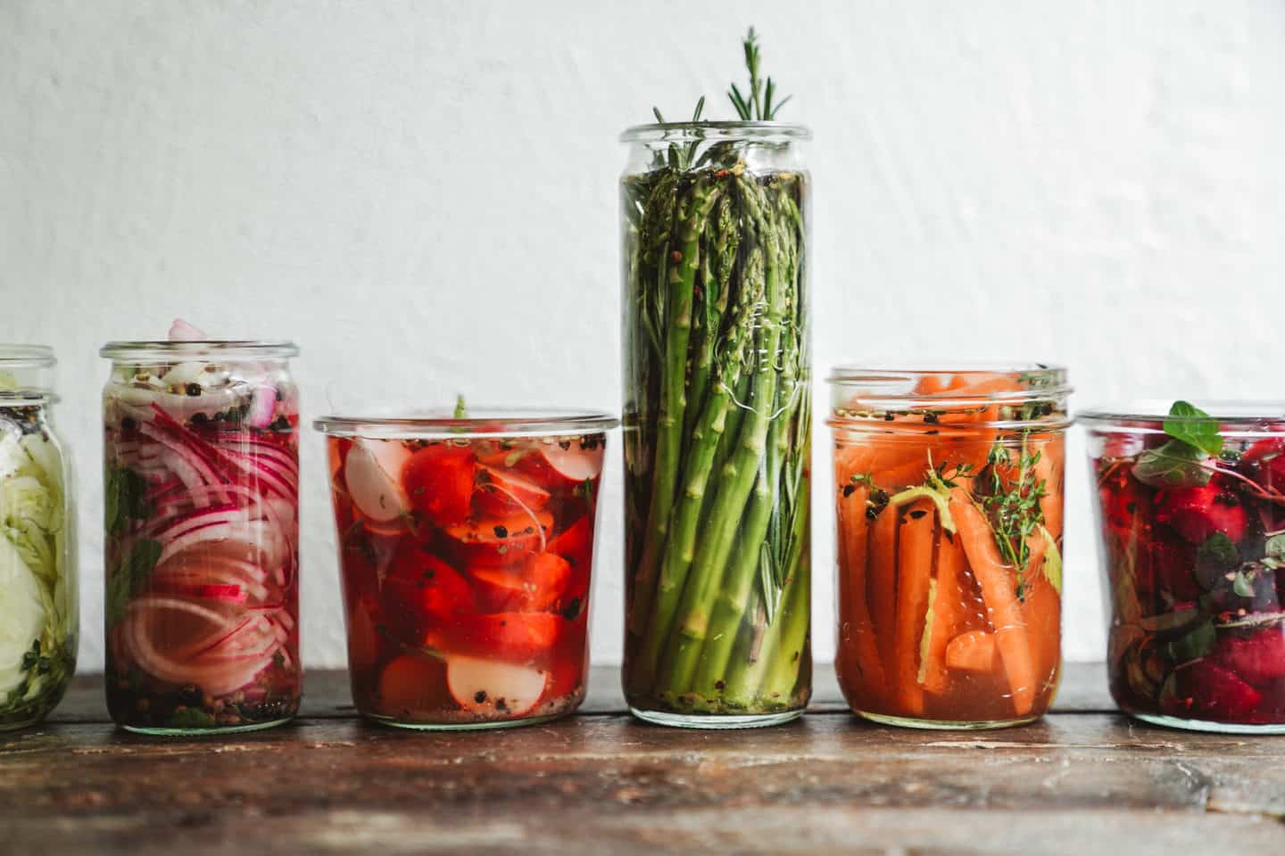 Pickled veggies lined up on wood countertop. A great recipe to make this September.