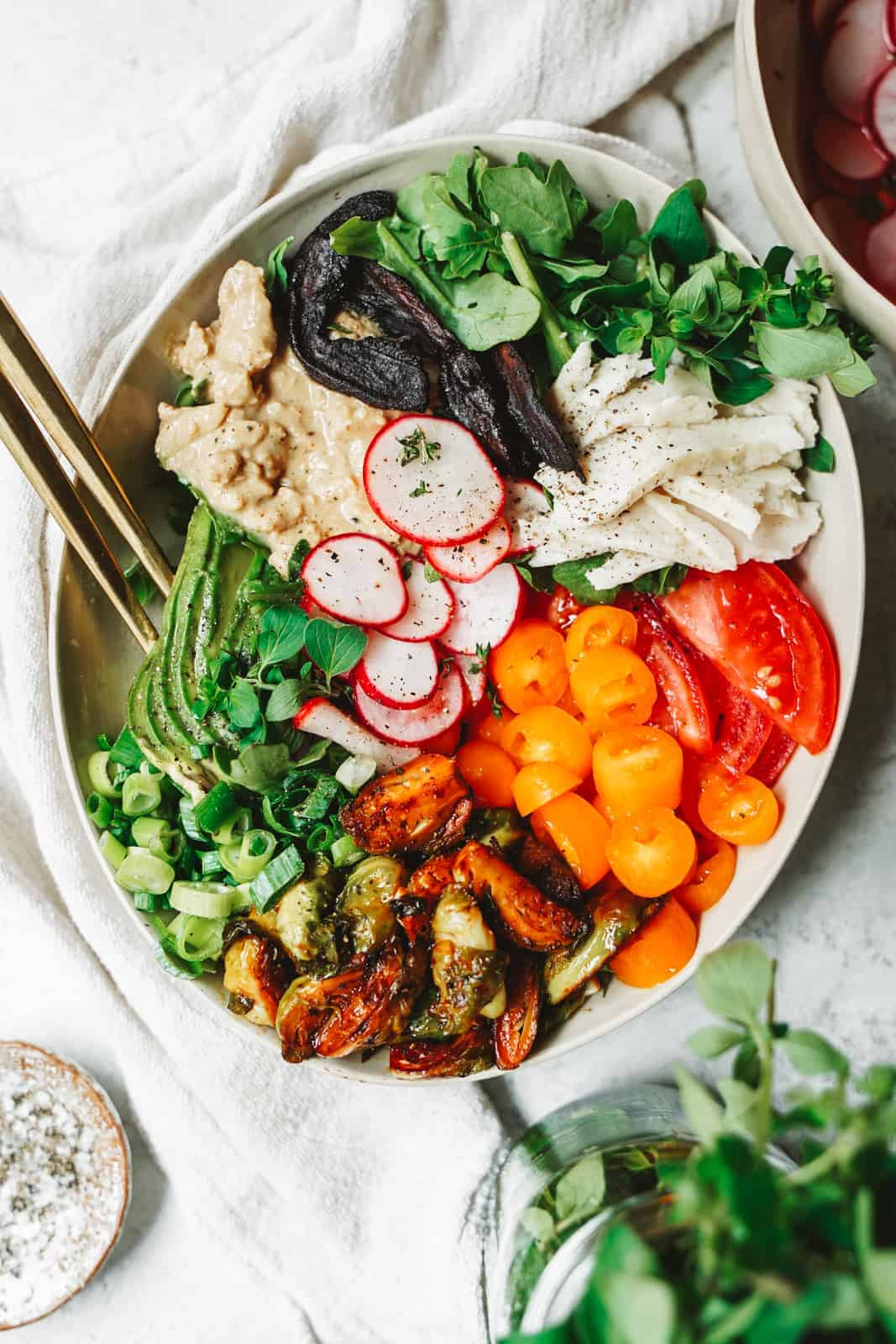 A colorful vegan cobb salad in a serving dish.