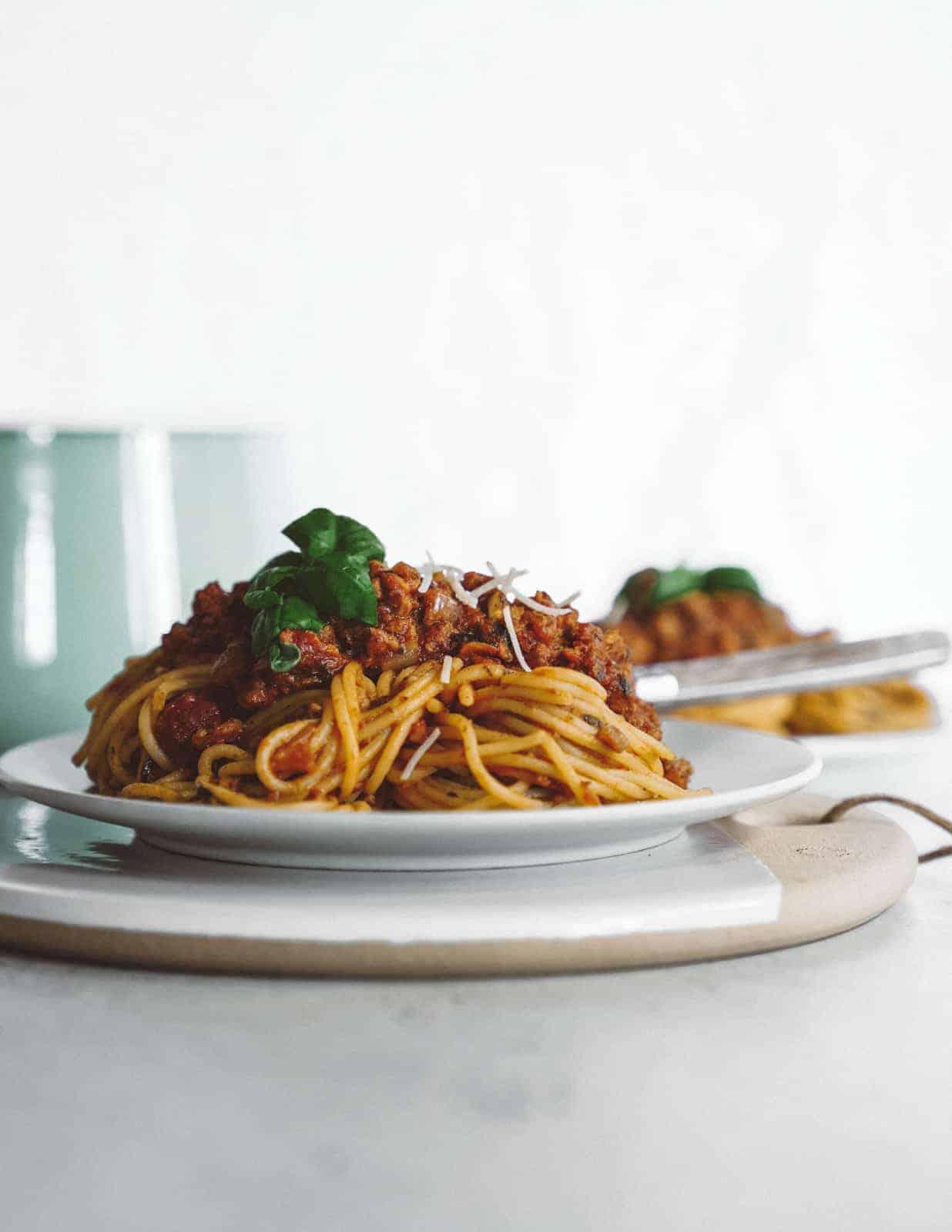 Pile of vegan spaghetti on white plate