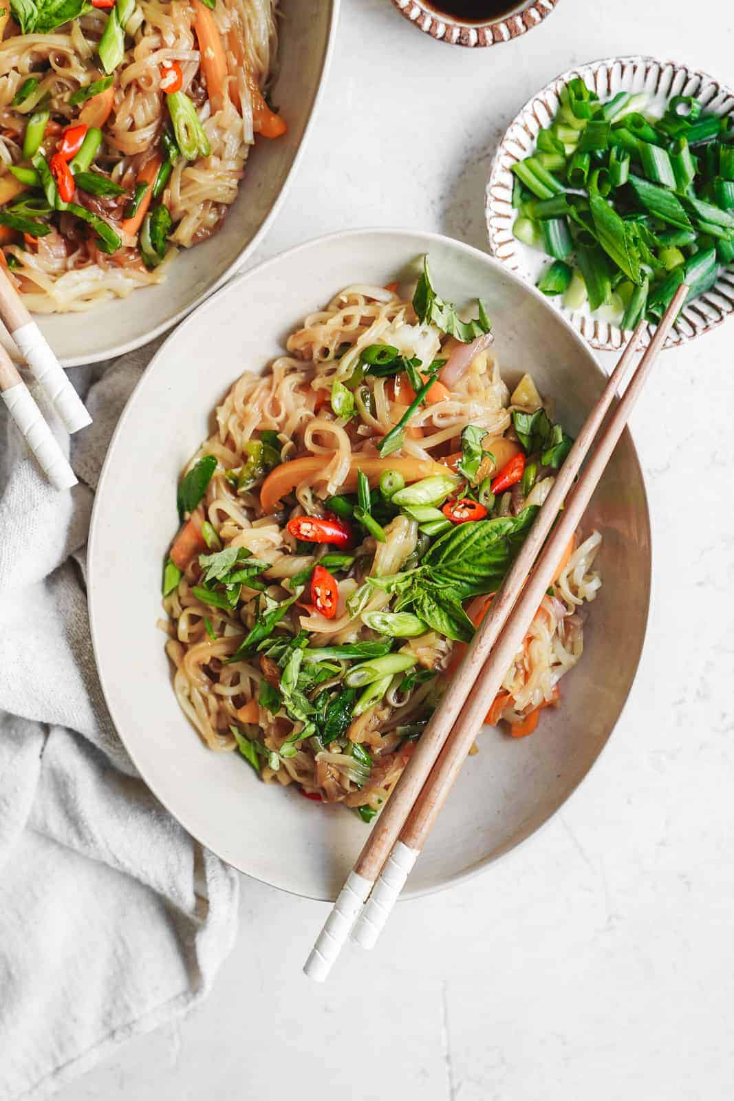 Easy 15-minute drunken noodles in bowl with chopsticks ready to eat.
