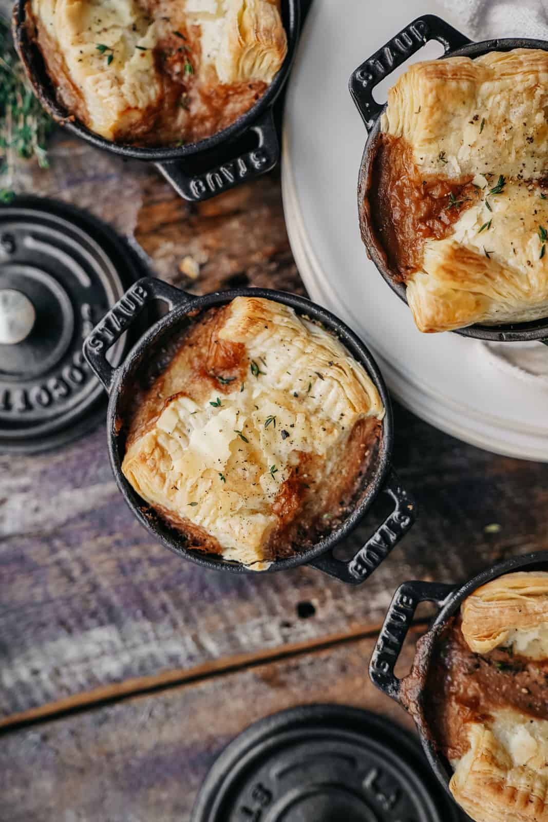 Ready-to-eat vegan pot pie with pastry crust in staub cocettes