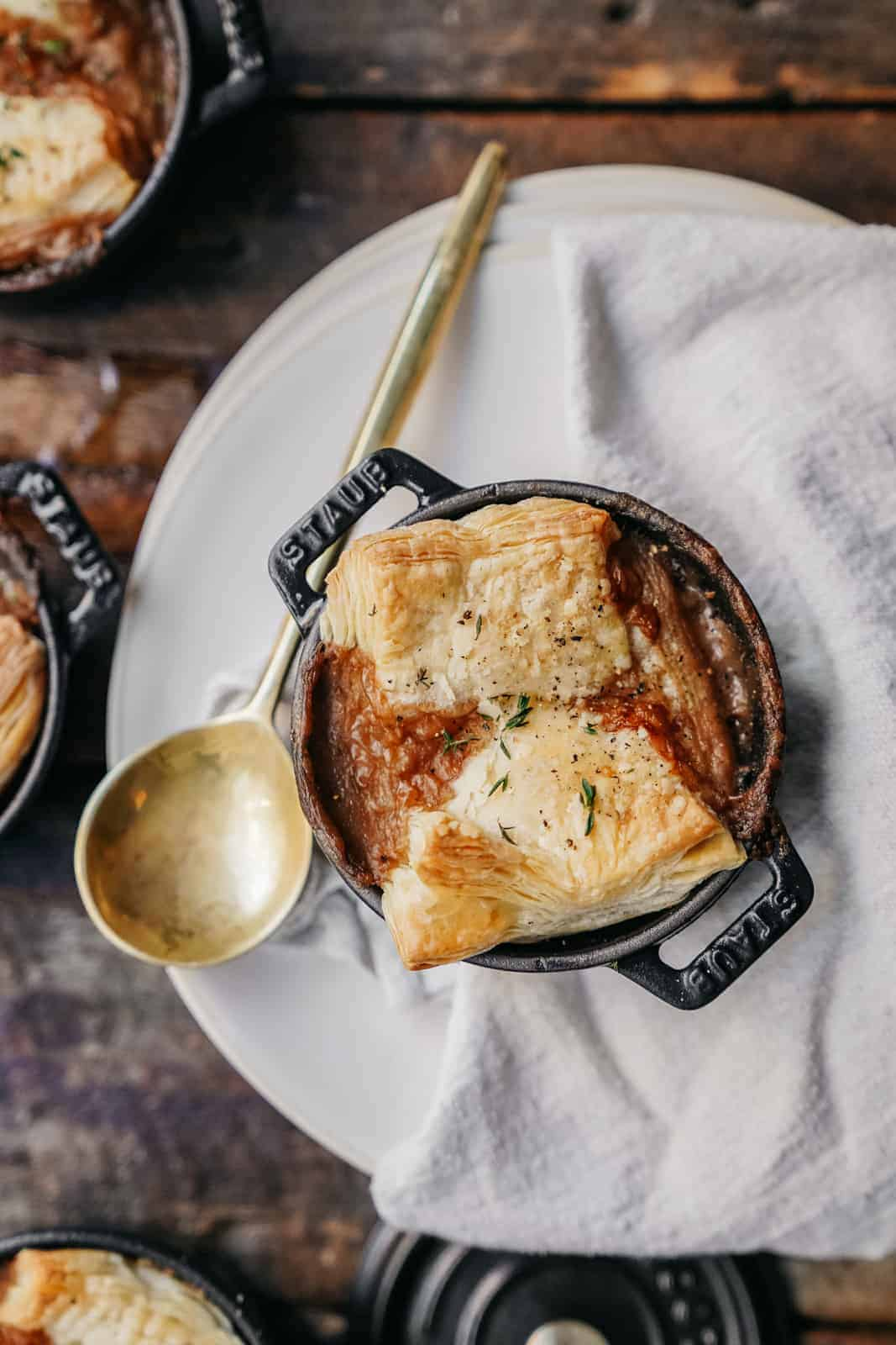 A pot pie on a wood board to demonstrate Maria's top food photography tips.