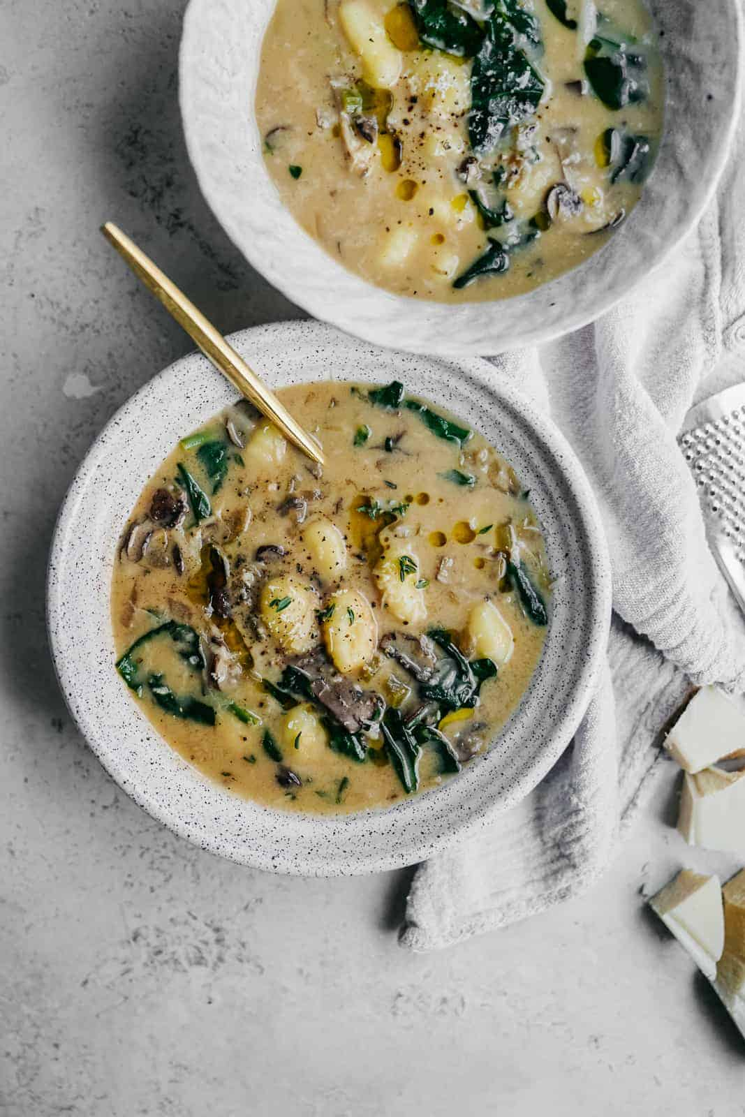 Spinach & Gnocchi Soup in a bowl with a spoon. A great soup idea for using gnocchi.