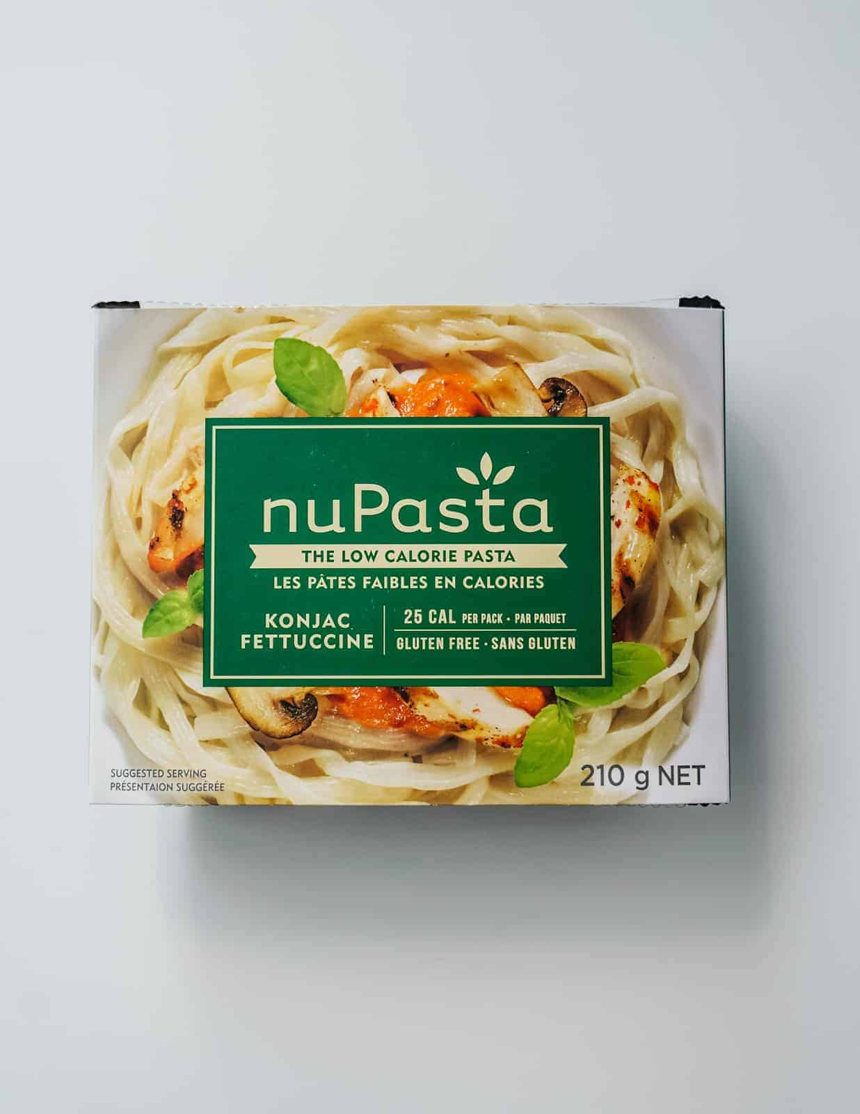 NuPasta in a box on a white countertop.