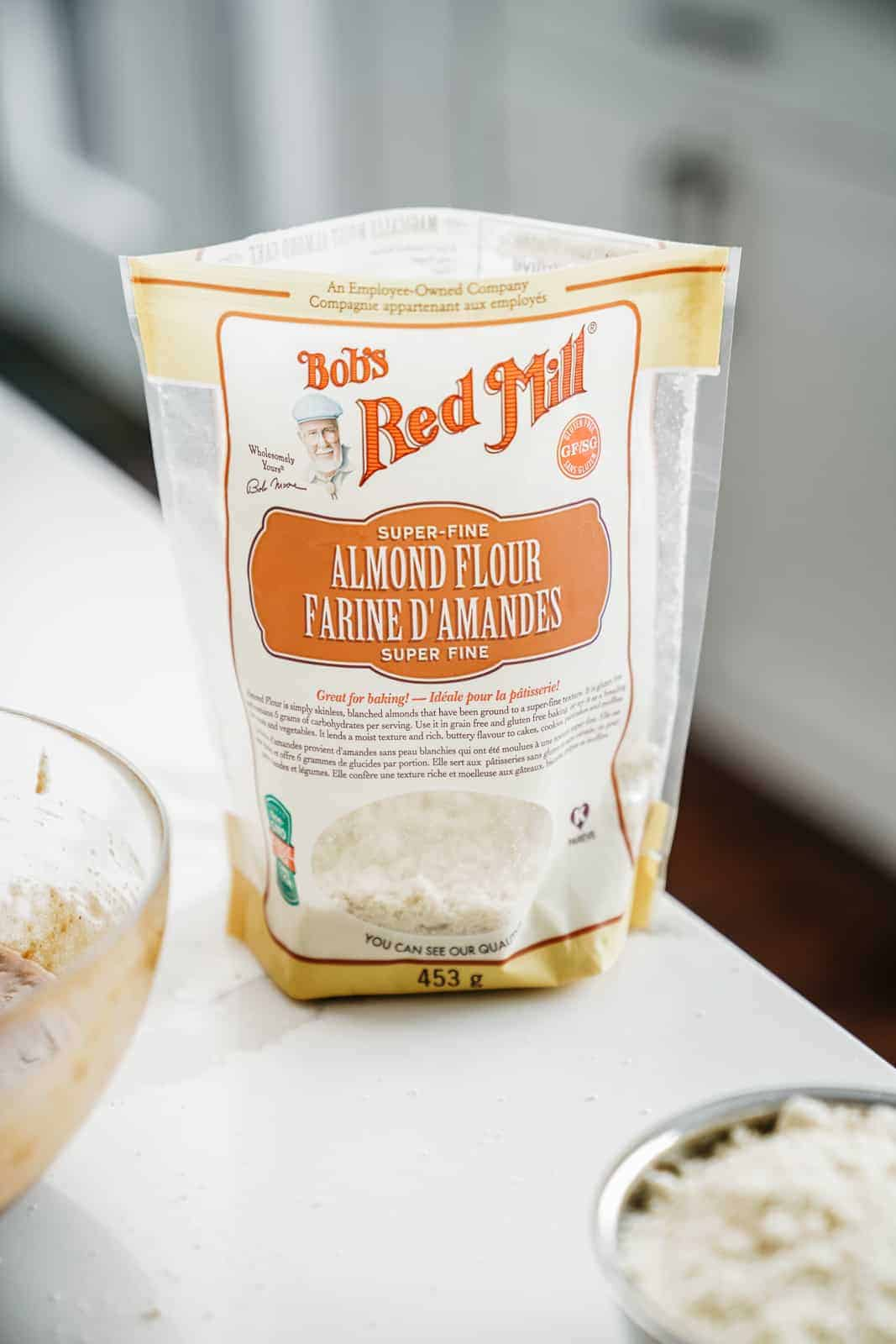 Bag of Bob's Red Mill Almond Flour sitting on counter.