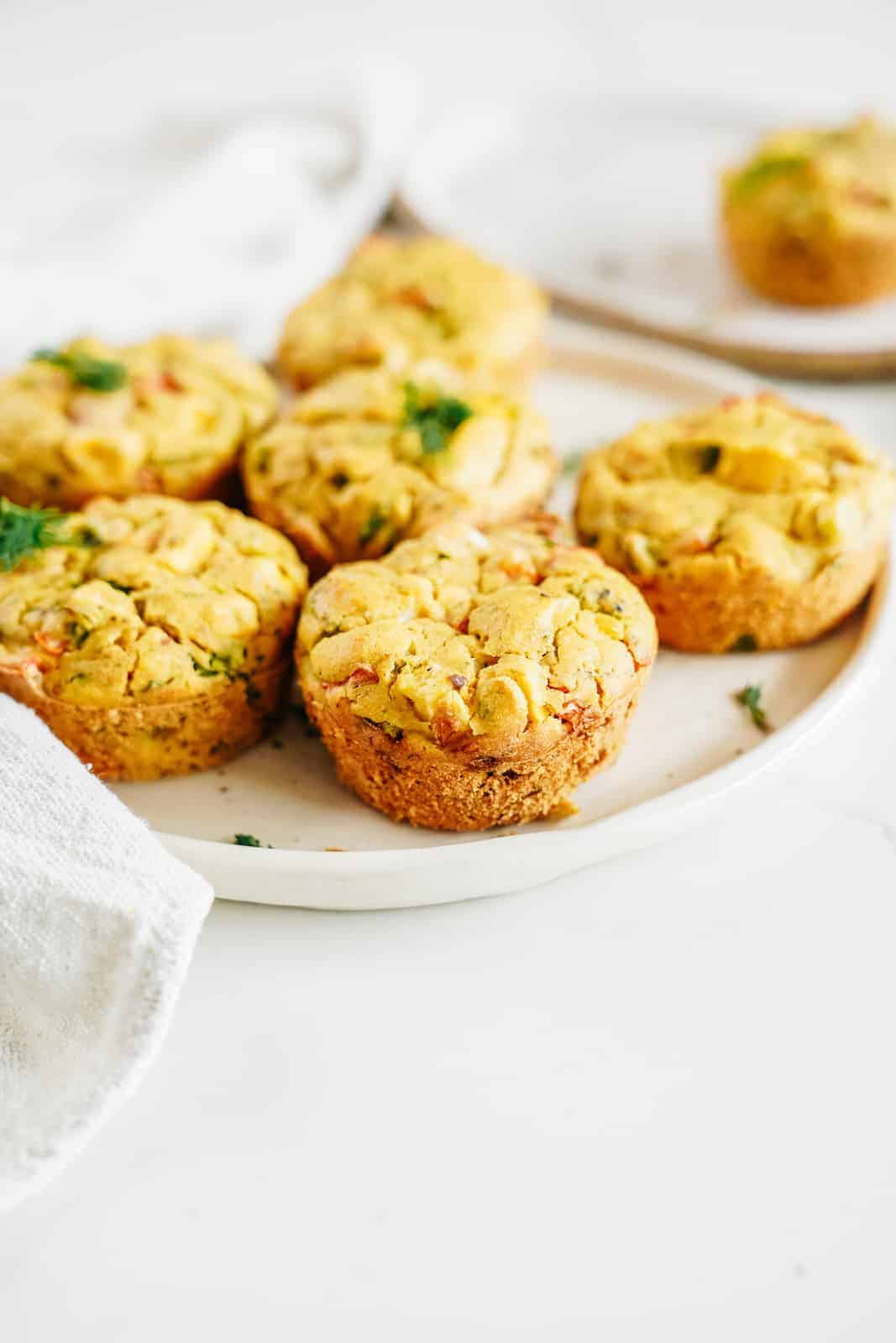 A plate of Savoury Vegan Chickpea Flour Muffins on a plate.