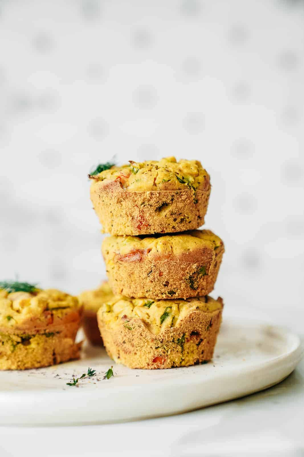 Stack of Vegan Chickpea Flour Muffins on a plate.