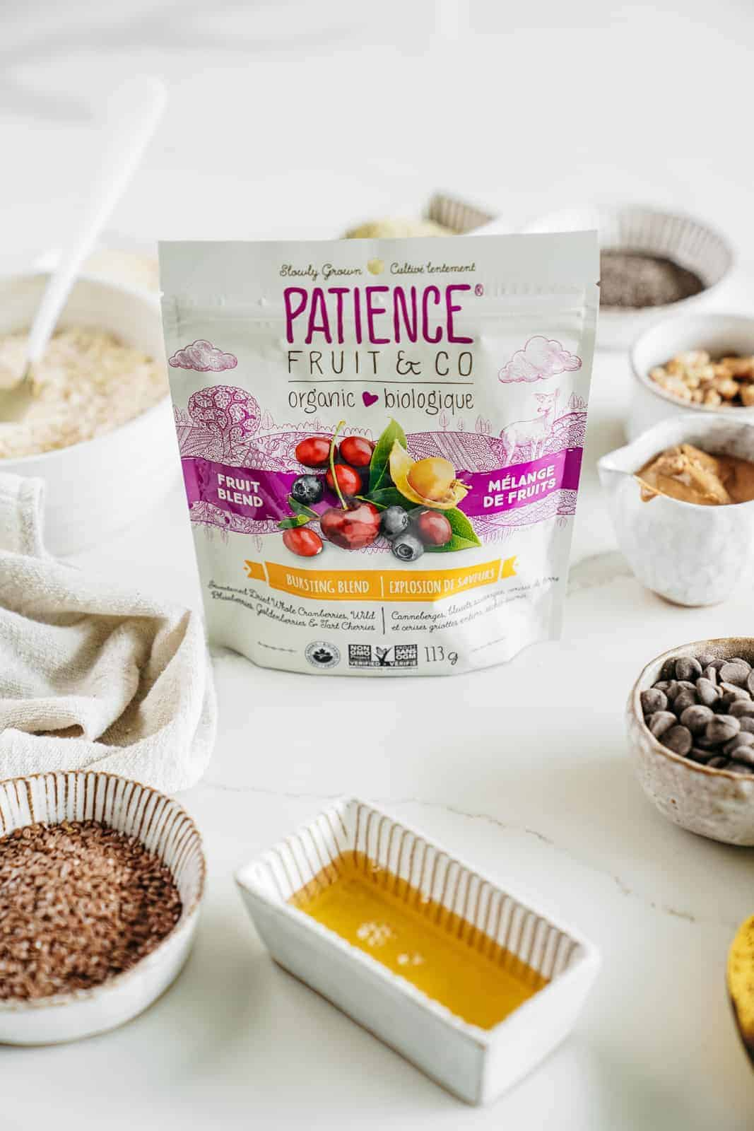 Patience Fruit & Co Berry Blend sitting on table with other ingredients for Vegan Granola Bars in the background