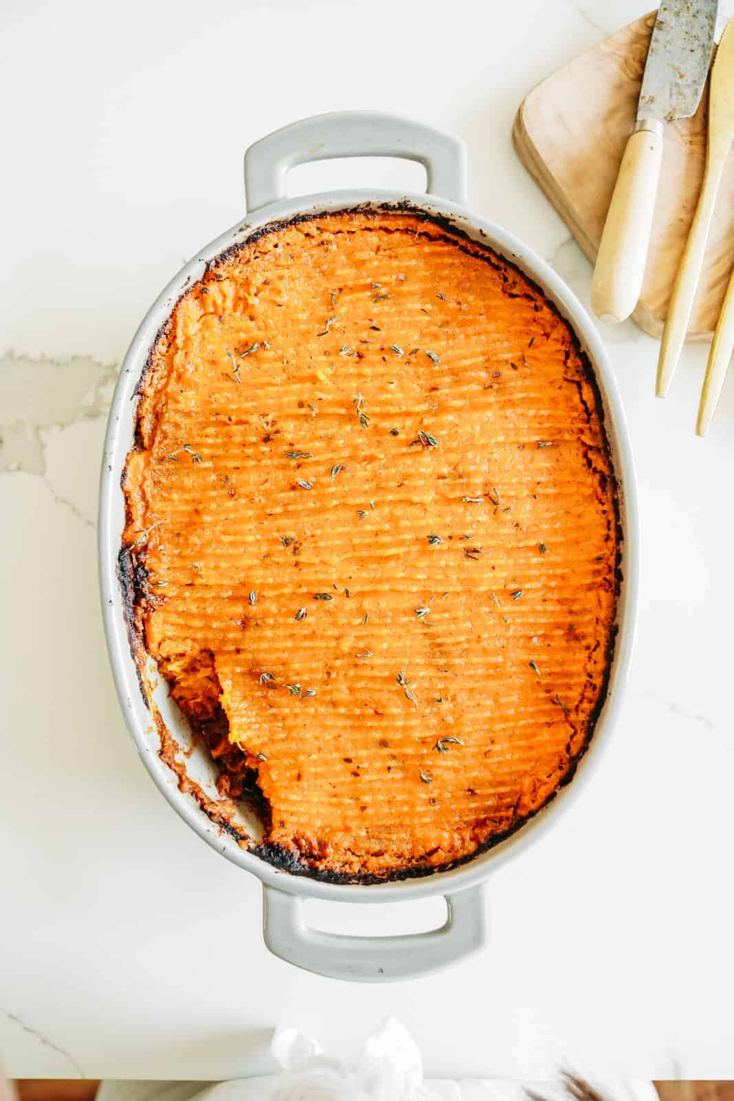 A casserole dish filled with yummy Shepherd's Pie with a sweet potato topping.