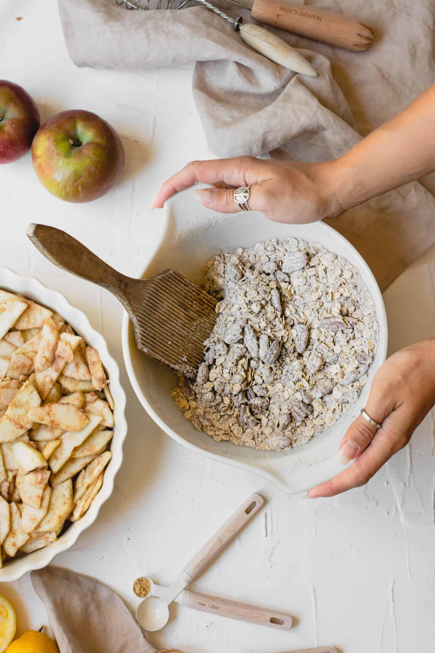 Dry ingredients for Vegan Apple Crumble in white bowl.