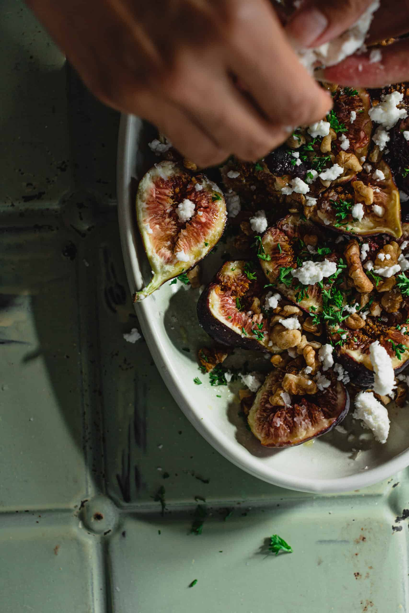 A close up of feta being added to the Simple Fresh Fig Salad