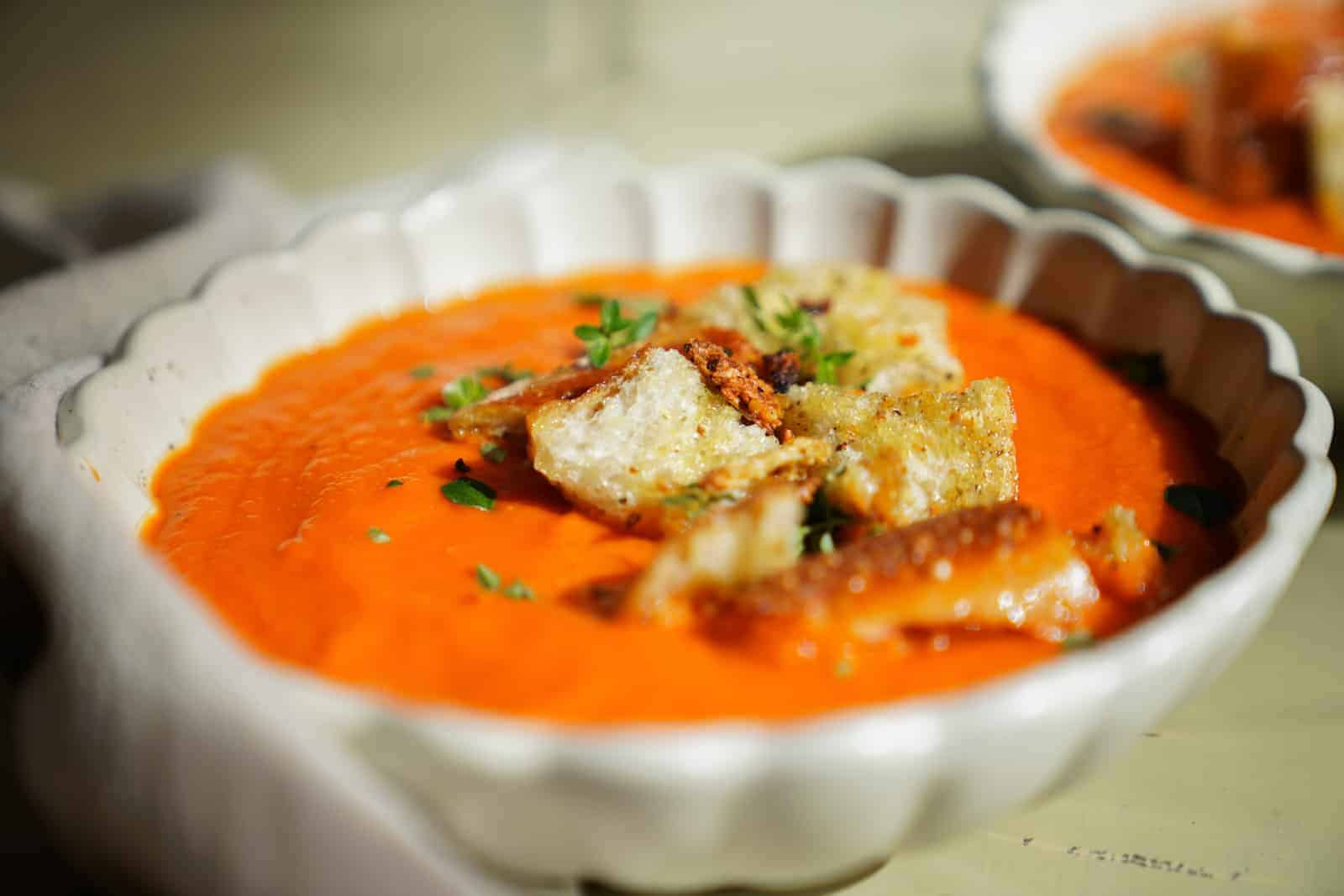 Side angle of Roasted Tomato Soup in white bowl