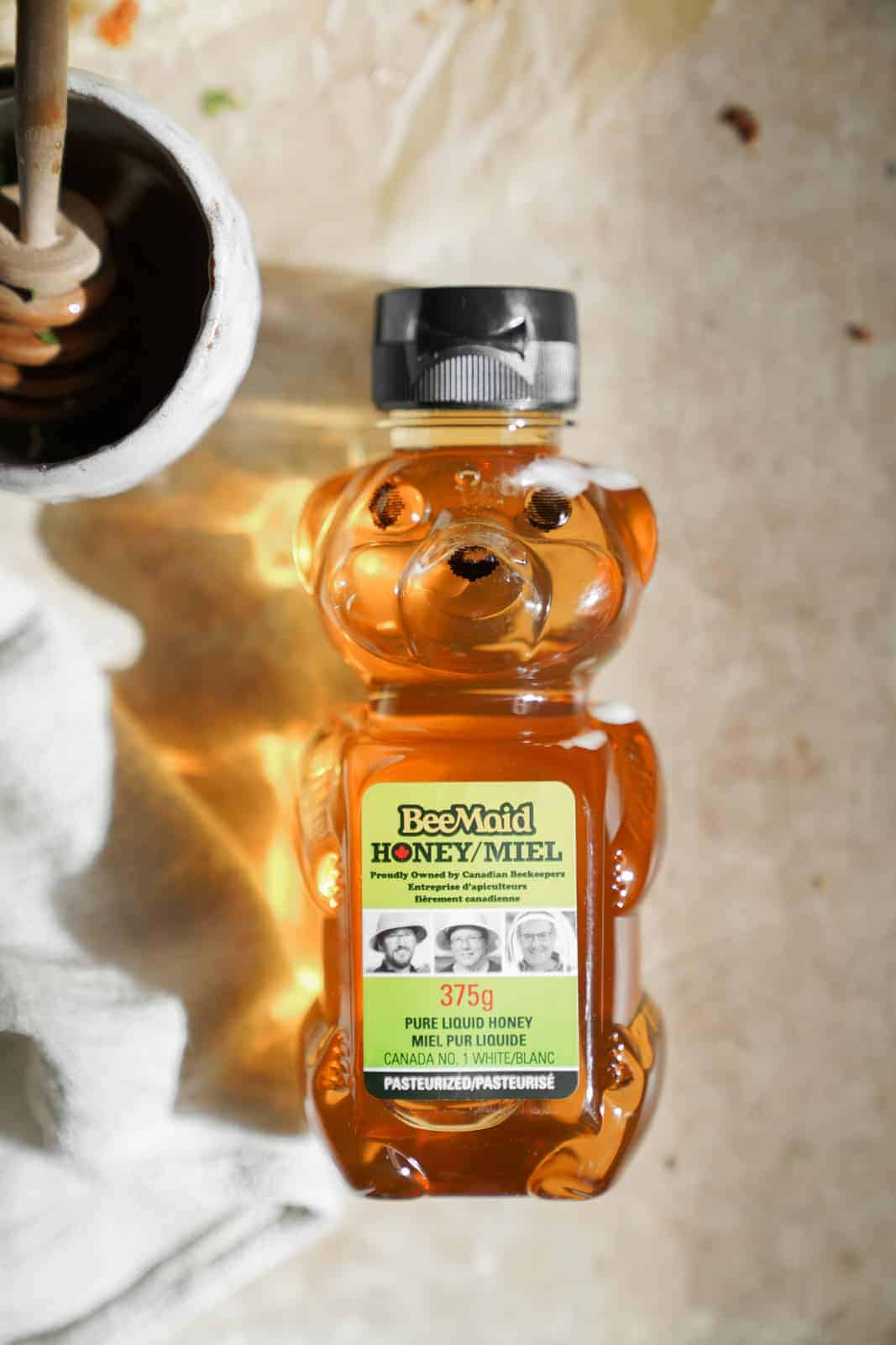 A bottle of honey shaped as a bear for the Vegetarian Breakfast Pizza