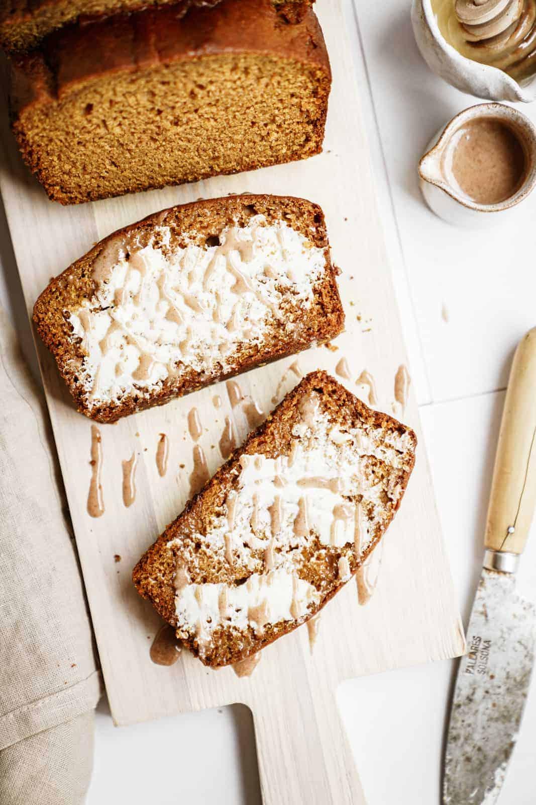 Sliced vegan pumpkin bread on cutting board