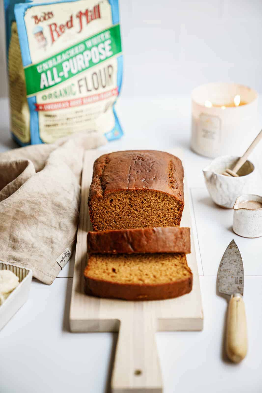 vegan pumpkin bread with bag of Bob's Red Mill flour in the back.