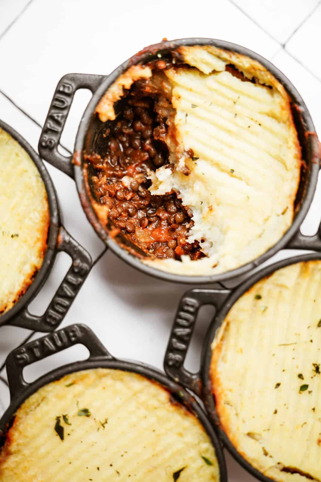 Lentil Shepherd's Pie in mini pots on counter