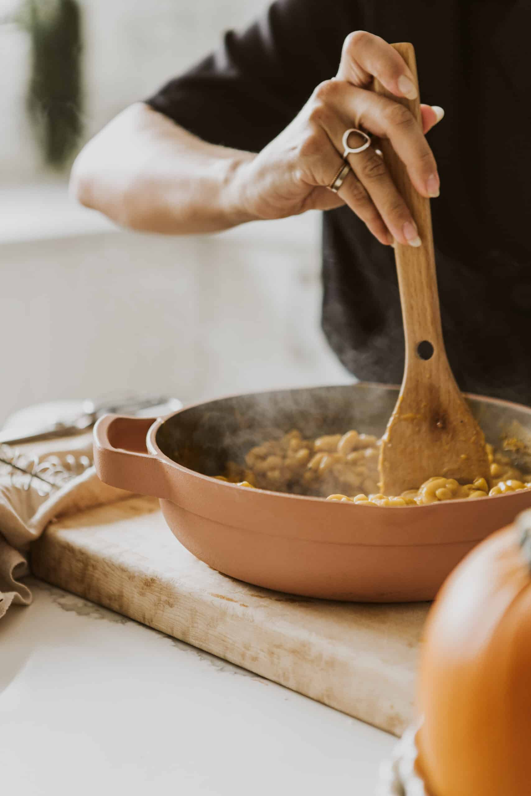 Vegan Pumpkin Mac and Cheese being stirred in a pot