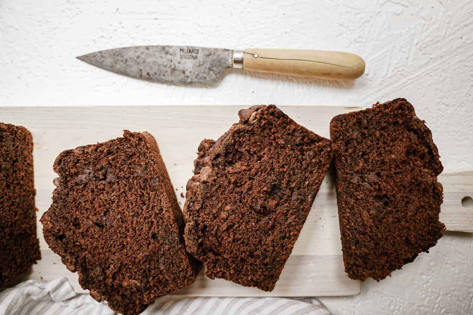 Slices of chocolate banana bread on cutting board