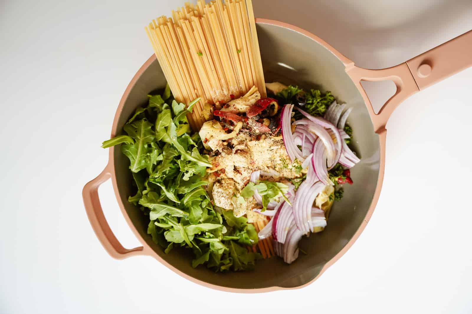 Fresh ingredients in one pot for one-pot vegetarian Greek pasta.