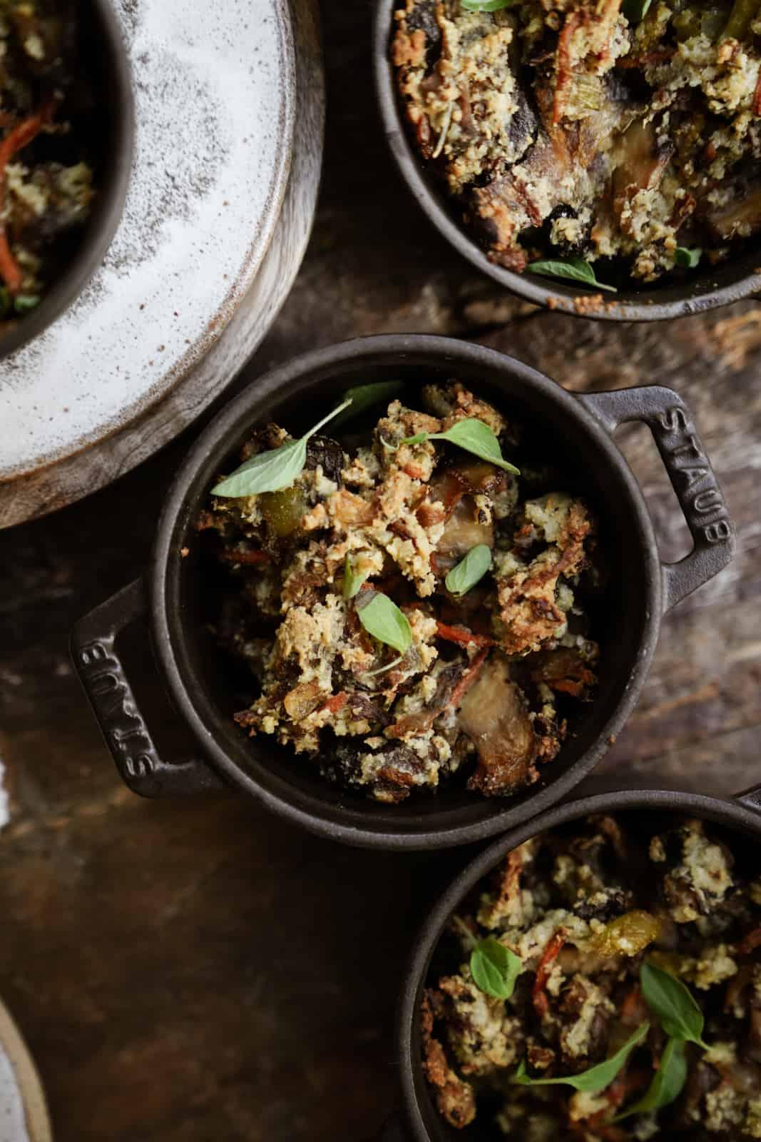 Vegan Gluten-Free Stuffingin mini pots on wooden table.