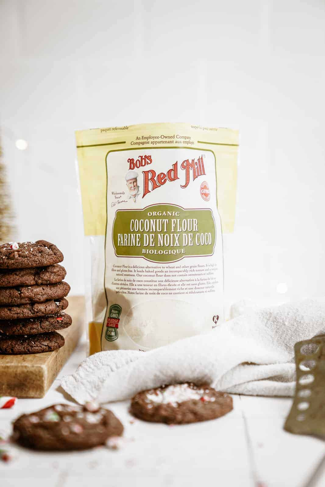 Bag of coconut flour next to stack of Chocolate Peppermint Cookies