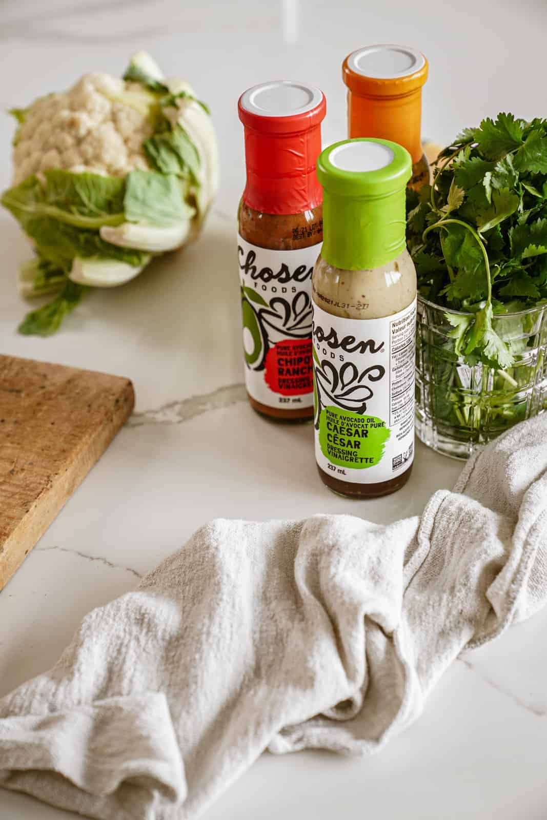 Chosen Foods salad dressings on countertop for baked tofu power bowl