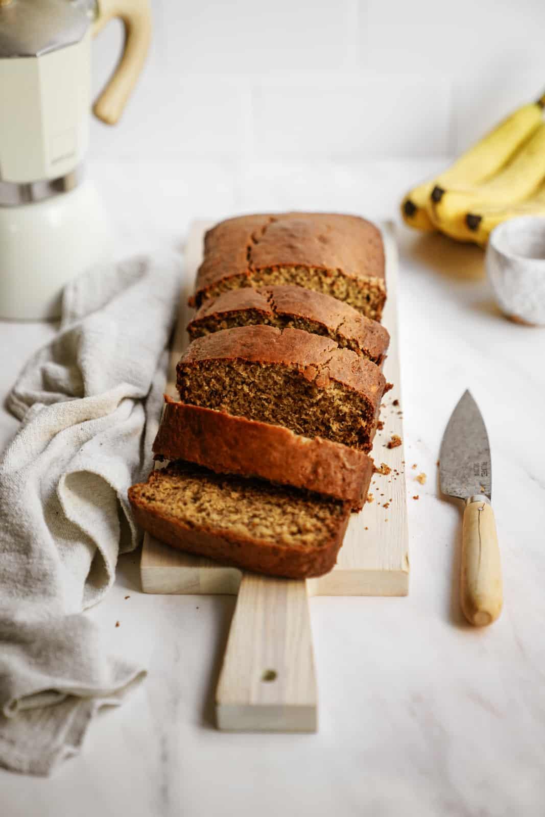 Healthy Banana Bread Recipe presented on a cutting board.