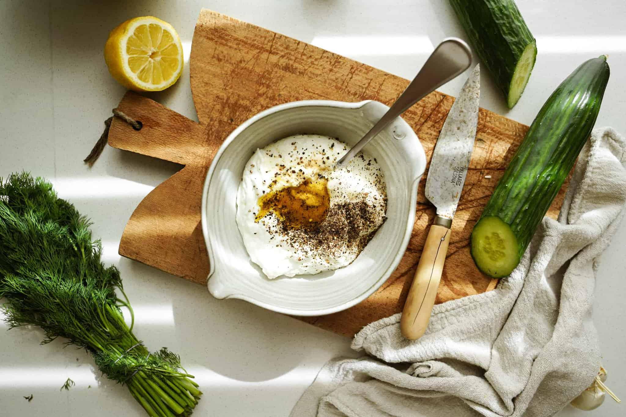 Ingredients for Greek Tzatziki Sauce in a bowl