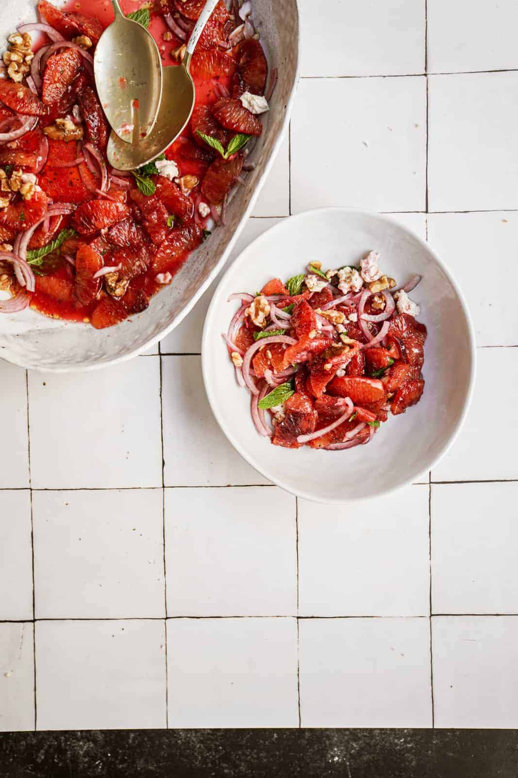Blood orange salad on white countertop in a serving dish