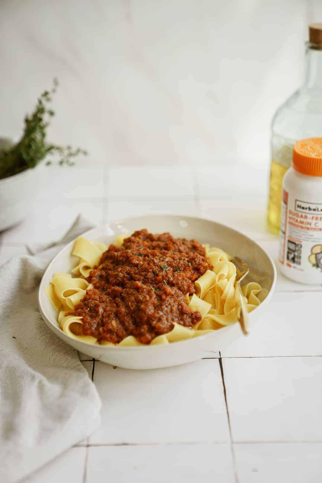 Vegan ragu in a serving dish on countertop