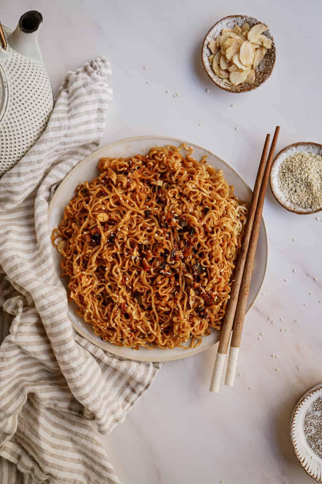 A plate of Vegan Sesame Garlic Noodles on a plate with chopsticks