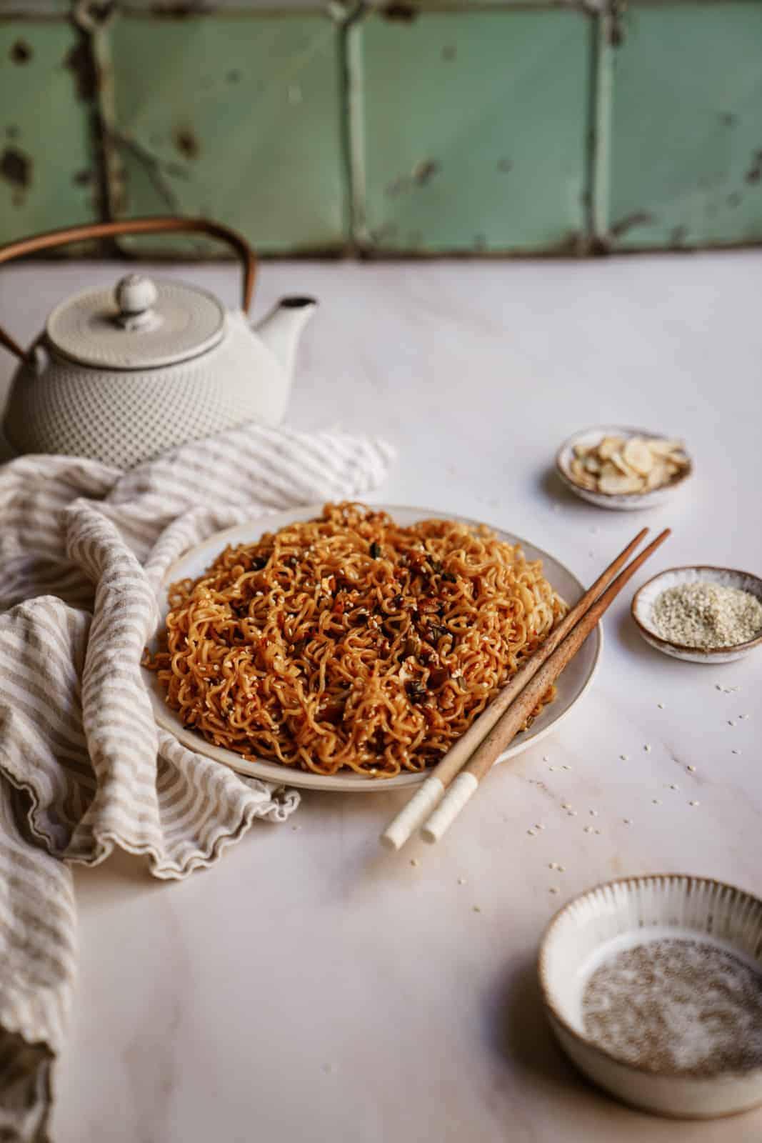 Vegan Sesame Garlic Noodles on a plate with chopsticks