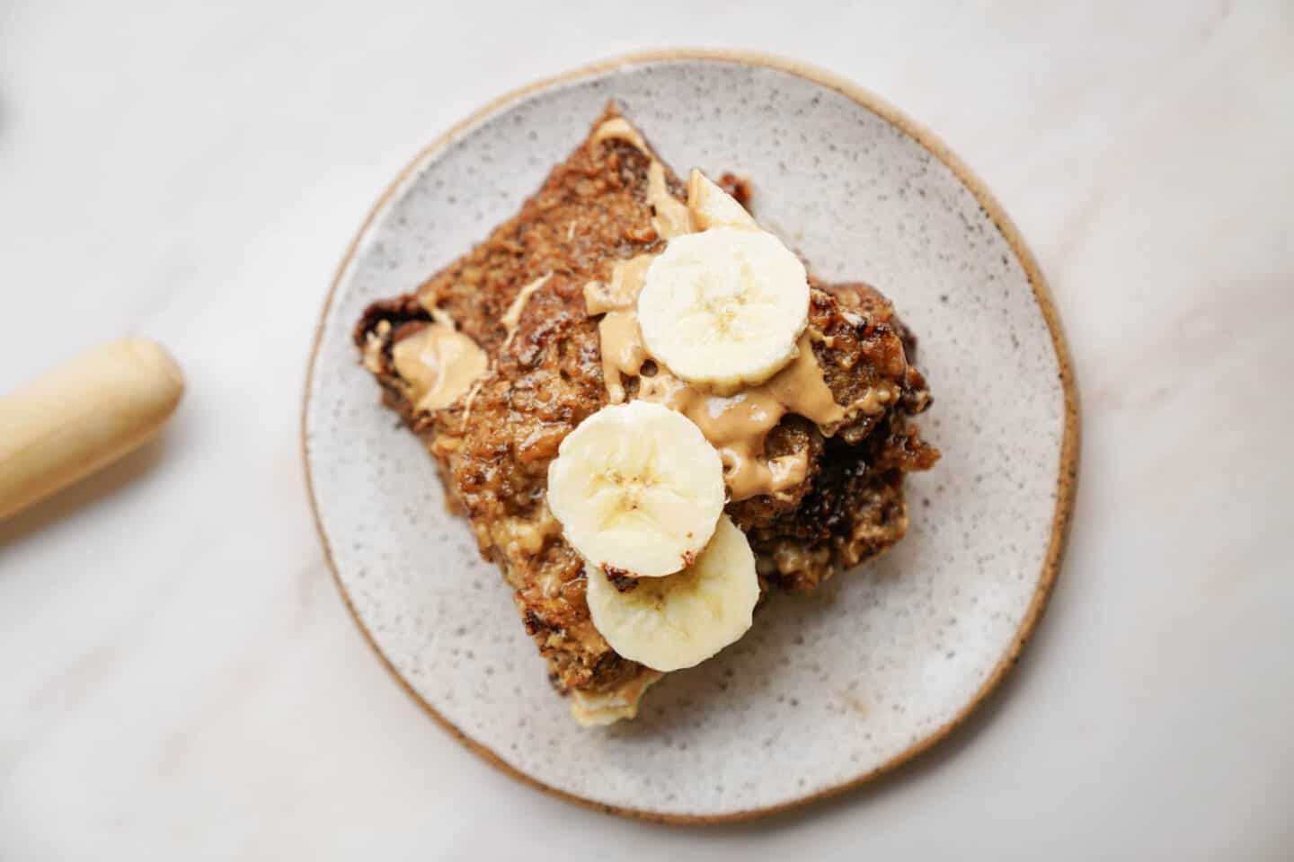 Vegan baked oatmeal with bananas cut on top.