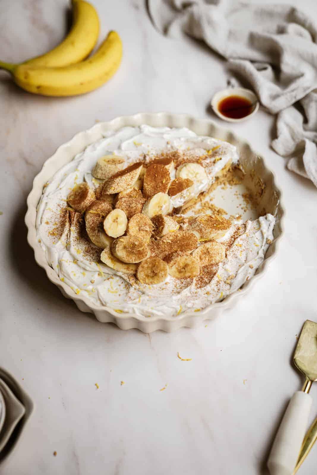Easy Vegan Banana Cream Pie on countertop in pie plate