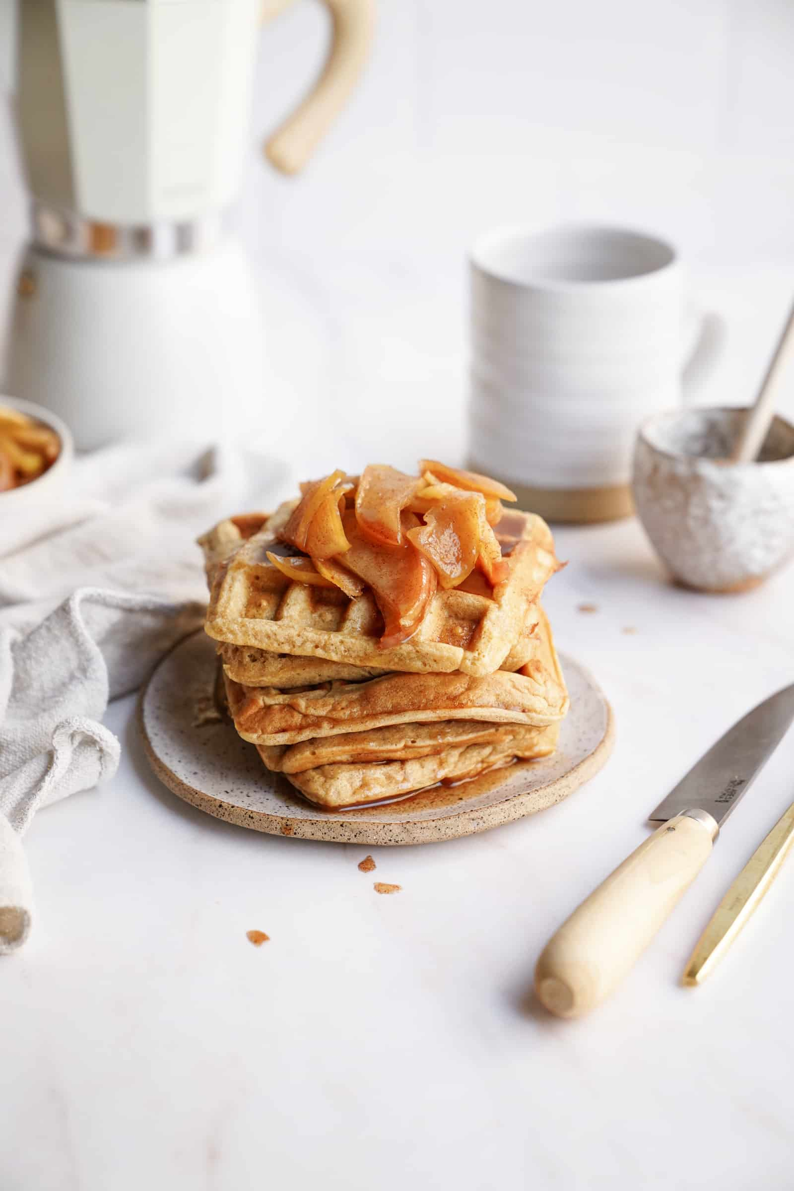 Apple Cinnamon Waffles stacked on a plate