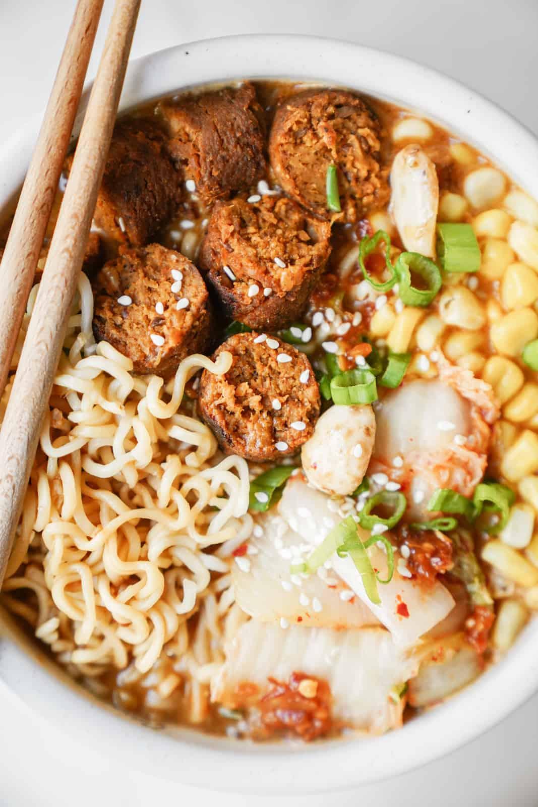 Vegan miso ramen bowl topped with vegan sausage